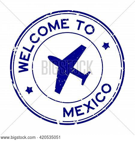 Grunge Blue Welcome To Mexico Word With Airplane Icon Round Rubber Seal Stamp On White Background