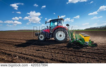 Varna, Bulagria - April 01, 2017. Big Steyr Tractor With Attached Great Plains Seeder For Sunflower