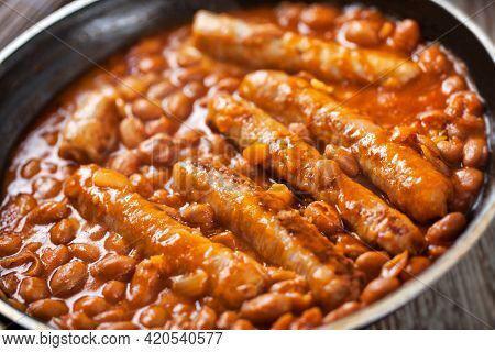 Sausage And Beans With Tomato Sauce On A Pan.