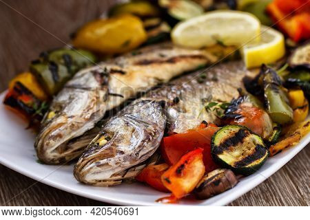 Sea Bass With Grilled Vegetables. High Quality Photo.