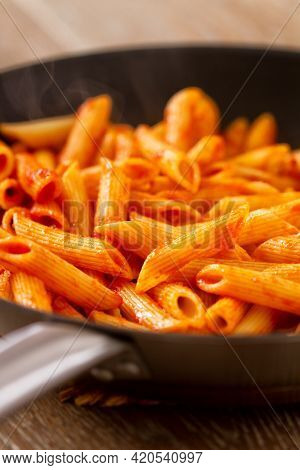 Pasta With Tomato Sauce On A Pan. High Quality Photo