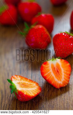 Strawberries On A Wooden Table. High Quality Photo.