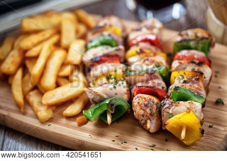 Chicken Skewers With Fries. High Quality Photo.