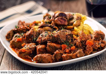 Polenta And Beef Stew On A Plate. High Quality Photo.