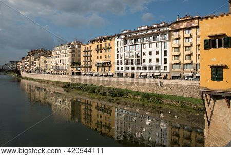 Florence, Italy, October 06 2017: Colorful Buildings Reflected On River Arno At Ponte Vecchio Floren