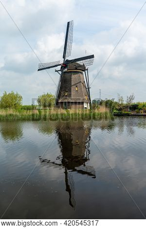 A Vertical View Of A Historic 18-century Windmill At Kinderdijk In South Holland