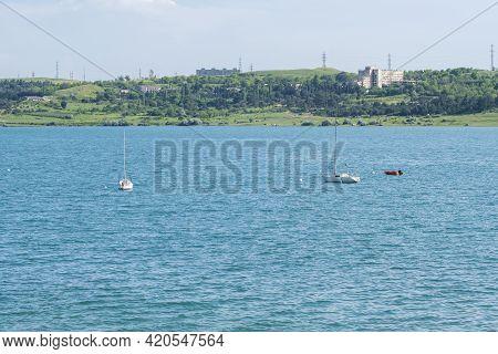 Tbilisi Sea And Boats With Deflated Sails