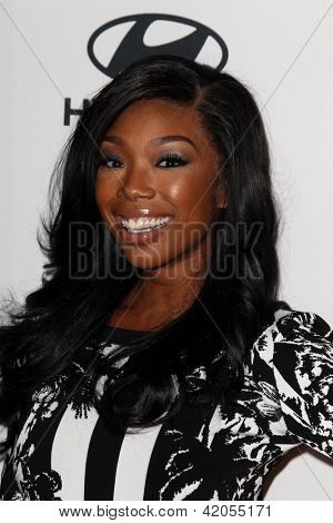 LOS ANGELES - FEB 9:  Brandy Norwood arrives at the Clive Davis 2013 Pre-GRAMMY Gala at the Beverly Hilton Hotel on February 9, 2013 in Beverly Hills, CA