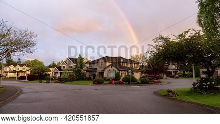 Street And Homes View At A Quite Residential Neighborhood In Suburban Area Of A Modern City. Colorfu