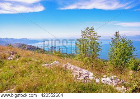 Beautiful Sunny Landscape In Mountains, Coast Of Lake. Montenegro. National Park Lake Skadar