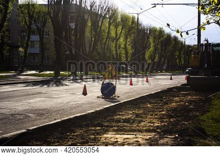 Road Works: Road Widening, Sidewalk Construction. Evening.