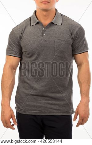 Young Male Model In A Dark Gray Shirt With Short Sleeve