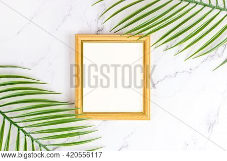 Top View Of Retro Wooden Empty Photo Frame With Natural Decorations, Branches And Leaves On Light Ba