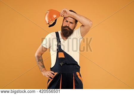 Feel So Exhausted. Repairman Fix Anything. Tired Man In Uniform. Mature And Experienced Builder In H