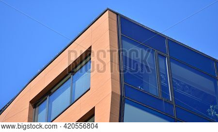 Mirrored Windows Of The Facade Of An Office Building. Abstract Texture Of Blue Glass Modern Office B