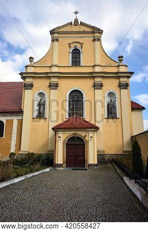 Facade Of Baroque Monastic Church In Poland