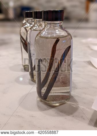 Glass Bottle With Vanilla Extract On Counter