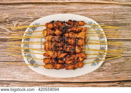 Malaysian Chicken Satay On White Plate, One Of Famous Local Dishes