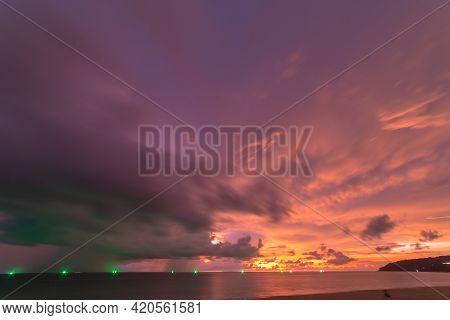Rain Cloud At Sunset Over Sea Water. Evening Landscape With Sun Over Sea Water.\npanorama Rain Cloud