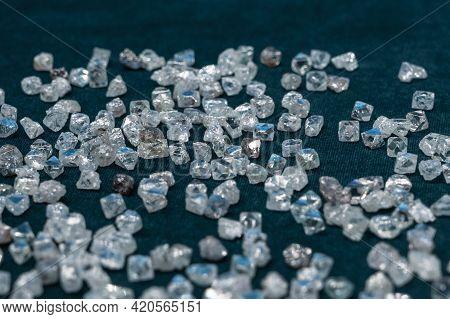 A Scattering Of Small Transparent Diamonds On Velvet.
