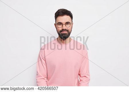 Confident Bearded Macho Man Looks Pleased At Camera Has Friendly Kind Grin On Face Wears Round Spect