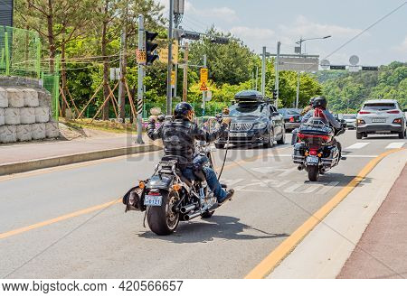 Daejeon, South Korea; May 2, 2021: Rear View Of Men On Motorcycles In Traffic At Intersection.
