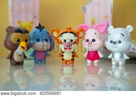 Samut Prakan , Thailand - May 16, 2021 : Cute Figurine Of Winnie The Pooh Is Random Figure Inside Fr
