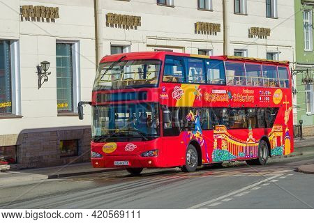 Saint Petersburg, Russia - April 18, 2021: Red Double-decker Excursion Bus On The City Street On A S
