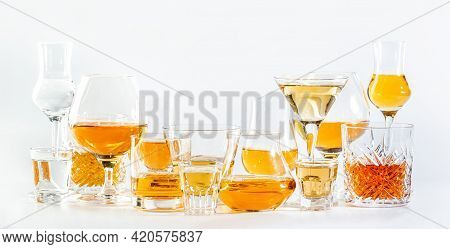 Hard Strong Alcoholic Drinks, Spirits And Distillates In Glasses In Assortment: Vodka, Cognac, Scotc