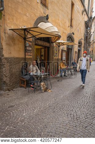 People On The Streets Of The Ancient City Of Orvieto In Umbria, Italy