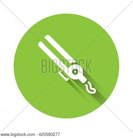 White Curling Iron For Hair Icon Isolated With Long Shadow. Hair Straightener Icon. Green Circle But