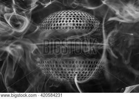 Conceptual Black And White Background Macro Photo Of A Tea Infuser With Smoke As An Alien Object Shr