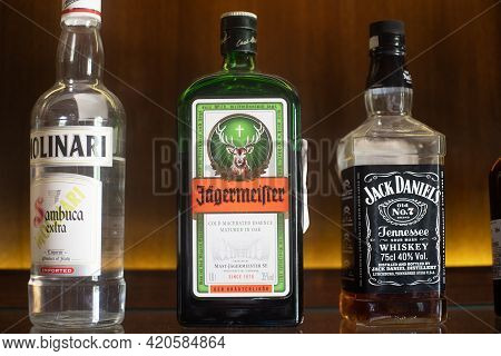 Bottles Of Liquor Alcohol Gin Rum Vodka On A Wooden Shelf In A Pub Bar Restaurant Hotel Or Home In I