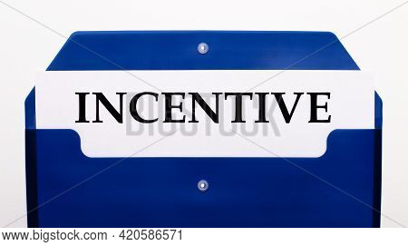 On A White Background, A Blue Folder For Papers. In The Folder Is A Sheet Of Paper With The Word Inc