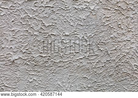 Texture And Background Of A Rough Concrete Wall Covered With A Cured Liquid Concrete Mixture With Sa