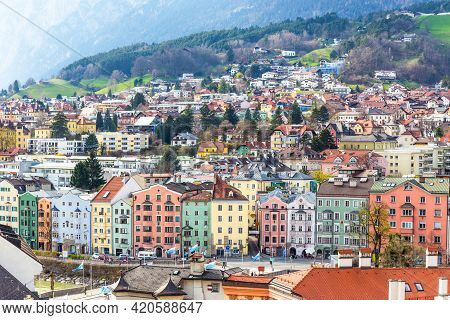 Innsbruck, Austria - 9 April 2015 - Aerial View Of Colorful Buildings And Mountains Of Innsbruck, Au