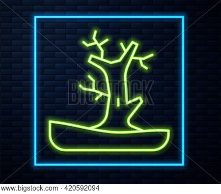 Glowing Neon Line Bare Tree Icon Isolated On Brick Wall Background. Vector