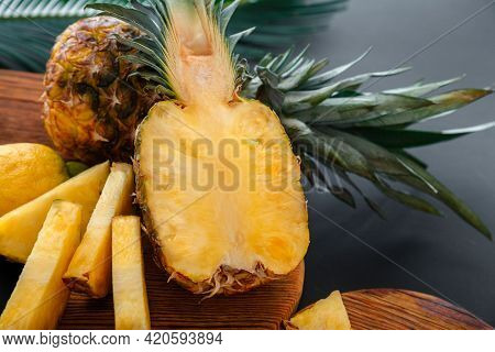 Pineapple On Cutting Board. Fresh Sweet Half Cut Pineapple And Whole Pineapple Fruit. Summer Fruit S