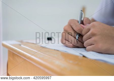 Asian Hands Student Testing In Exam On Exercise Taking At High School Or University In Test Room. Wr