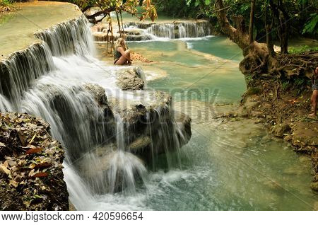 Laotian People And Foreign Travelers Travel Visit And Play Swimming Shallow Water Pool Atop Of Tat K