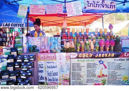 Lao Woman People Sale Soft Drinks Water Juice And Food Snack For Laotian People And Foreign Traveler