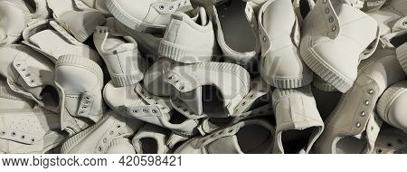 A Large Number Of Identical Sports Shoes. Lots Of White Sneakers Shoes. A Pile Of Shoes Without Lace
