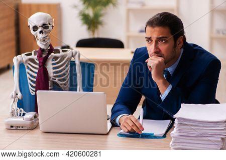 Dead employee working in the office
