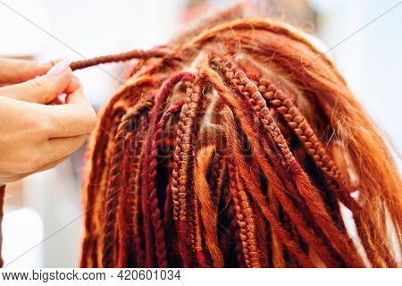 Close Up Of Braiding Process Plait With Colored Kanekalon. Beauty Salon Services. Girl Hairdresser W