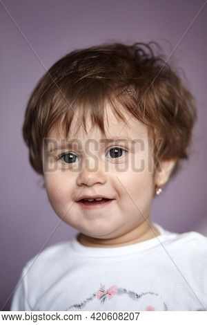 Portrait Of Cute Adorable Smiling Caucasian Baby Girl One Year Old. Close Portrait Cute Baby Girl.