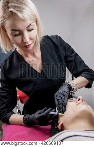 Cosmetologist Doctor Is Making Multiple Injections Biorevitalization With Hyaluronic Acid In Woman F
