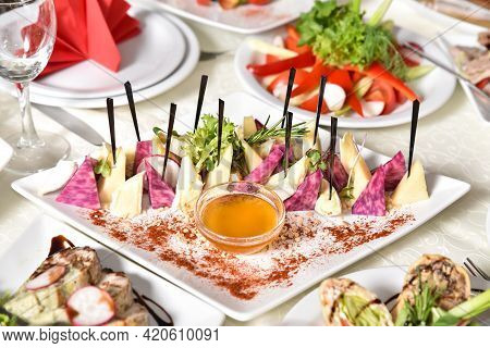 Set Of Cheese Decorated With Herbs And Honey. Banquet Table With Delicious Food In A Restaurant. Pro