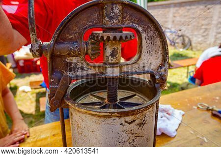 Close Up Shot On Gears Mechanism Of An Old, Rusty, Manually Machine For Making Domestic Sausages At