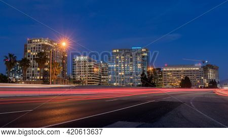 San Jose Downtown And Car Light Trails On California State Route 87 During The Blue Hour. San Jose,