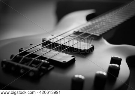 Closeup Shot Of A Smooth Body, Pickups, Bridge, Knobs And Strings Of A Bass Guitar Musical Instrumen